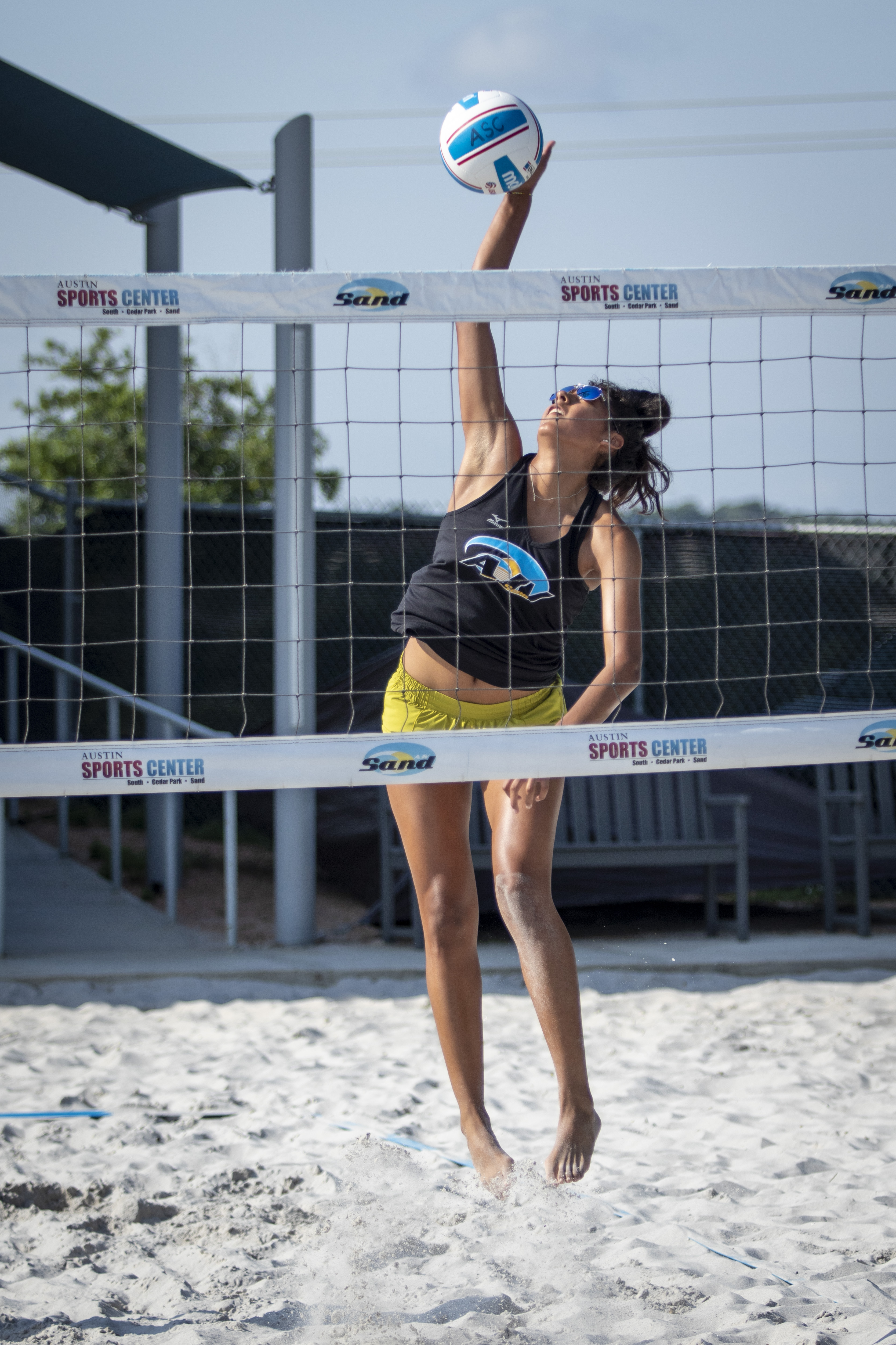 girl playing sand volleyball