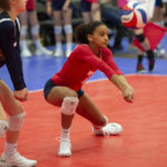 girl passing volleyball